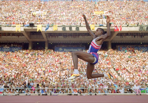 Carl Lewis of the USA flies through the air during