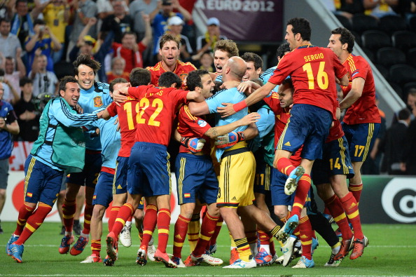 Spanish players celebrate at the end of