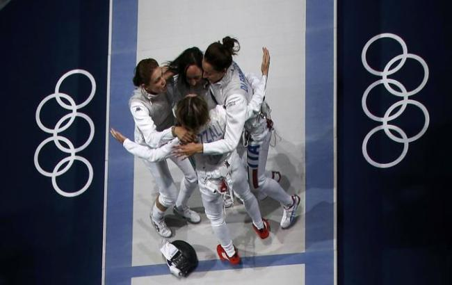 Italy's players celebrate after winning against Russia in their women's foil team gold medal fencing match during the London 2012 Olympic Games